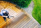 Man cleaning garden decking