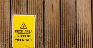 slip warning sign on decking