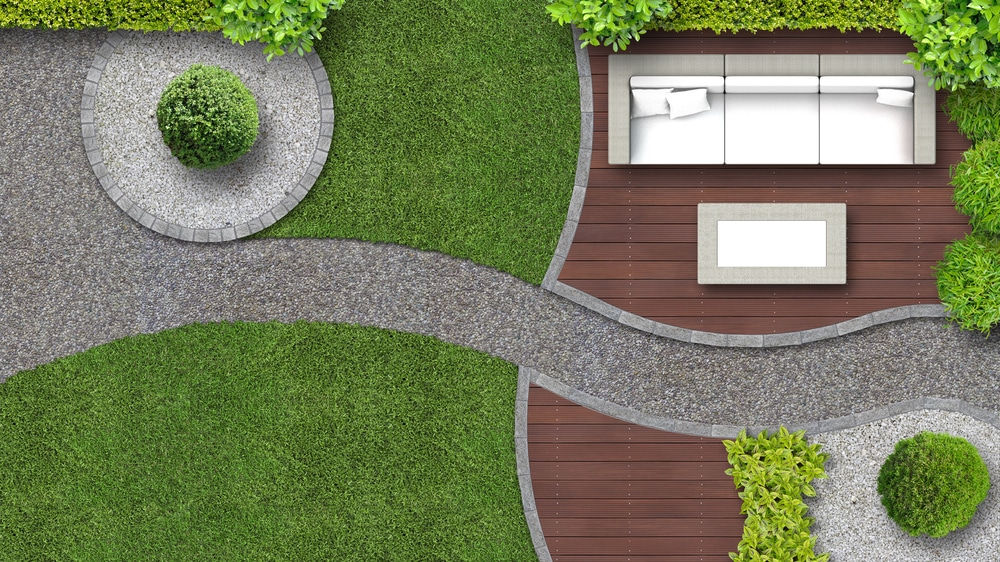 modern, bold garden with styled edging between lawn and stone