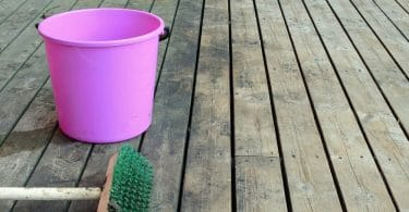 decking cleaned with bucket and brush