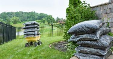 mulch piled high on a garden trolley