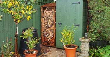 small storage shed in a tiny English garden