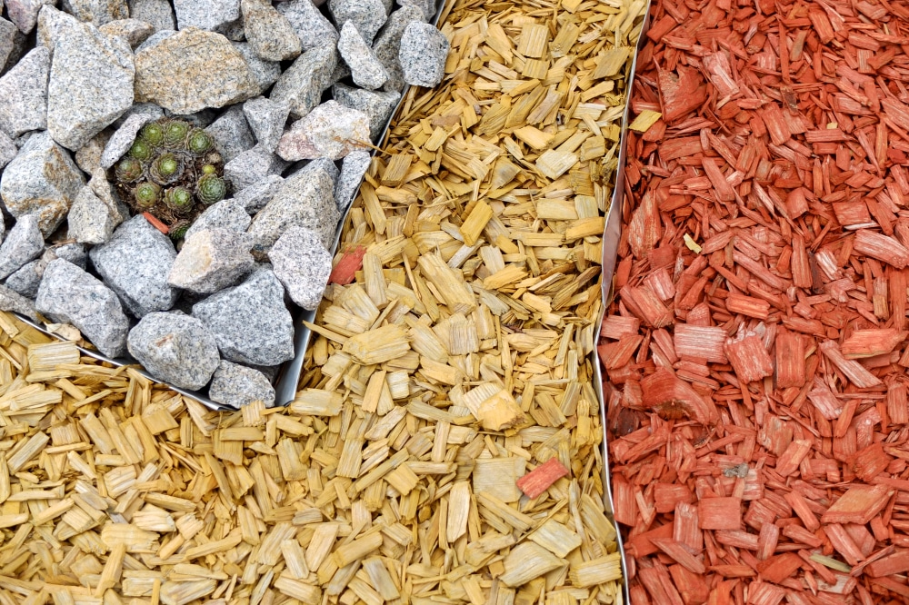 Dark red and light brown mulch used in garden