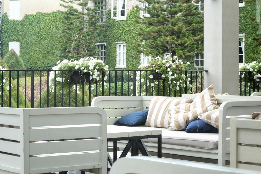 white benches in british garden