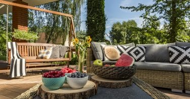 garden swing seat in a decked garden