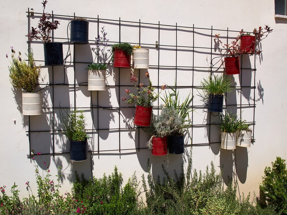 Modern mesh with attached metal plant pots