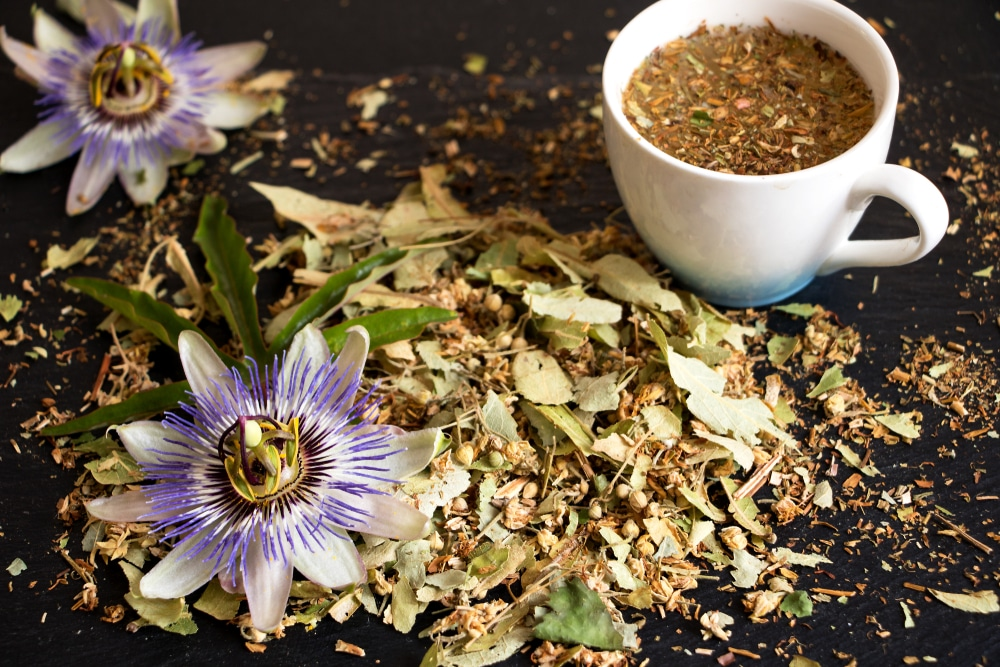 Dried passion flower leaves sat in a ceramic mug