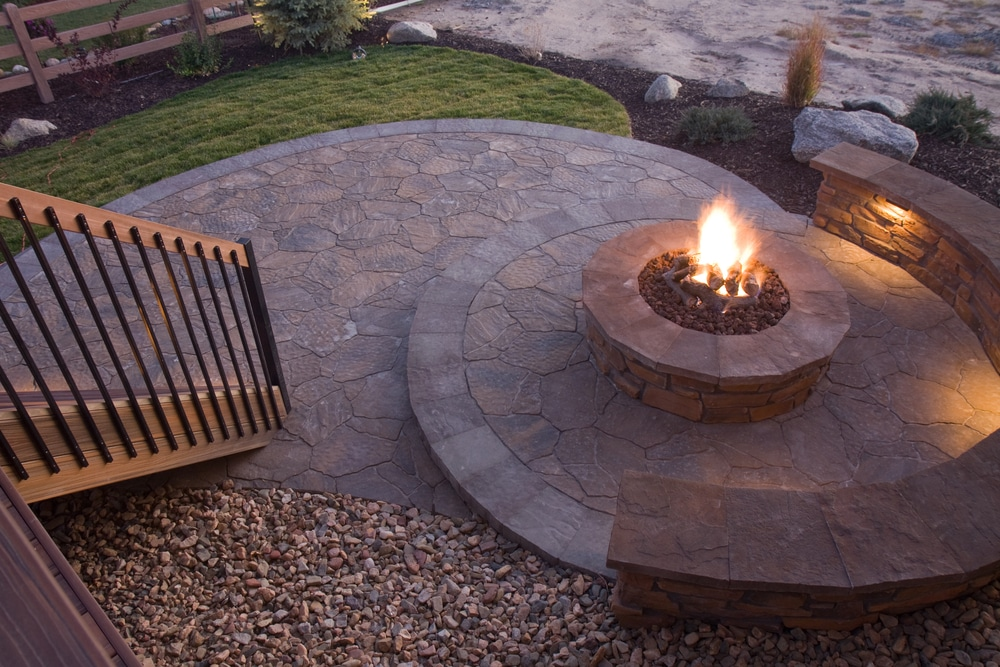 A beautiful fire pit with rounded edging and stairs