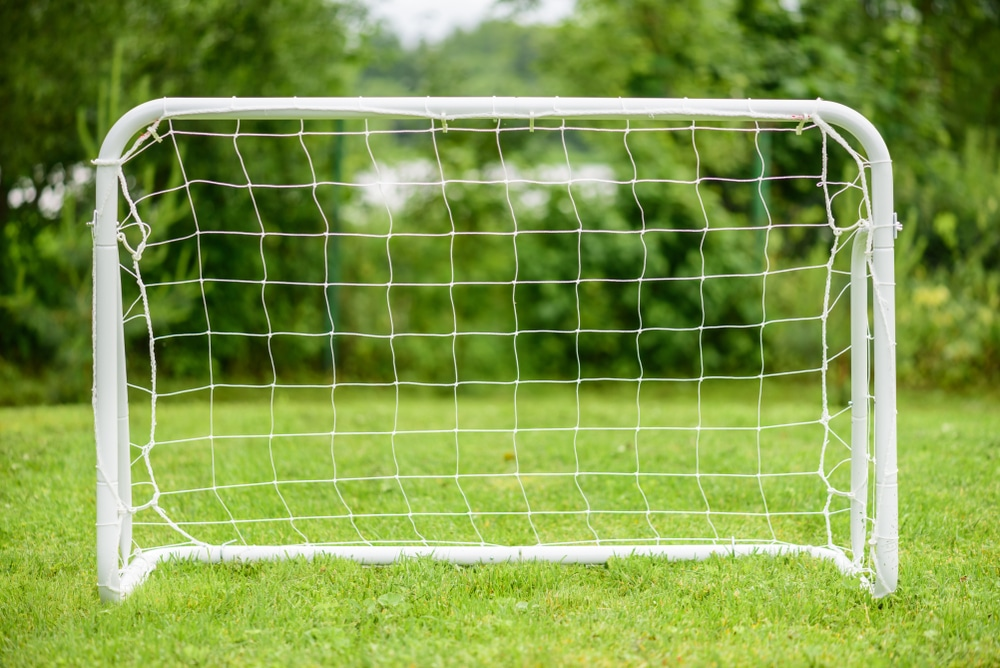 portable football goals on garden lawn