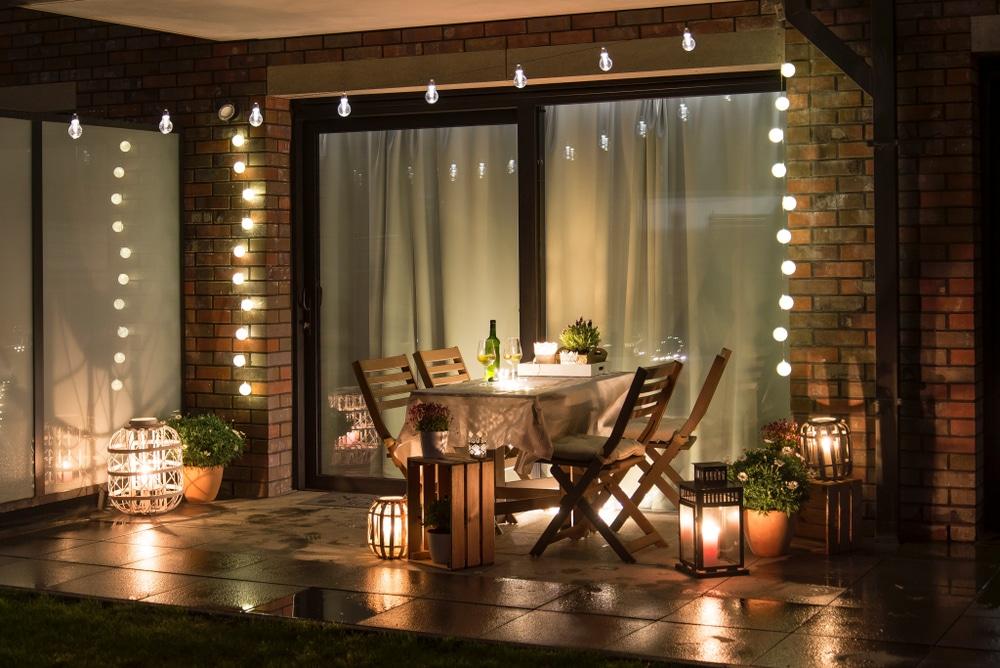 patio area with lighting around sliding glass doors