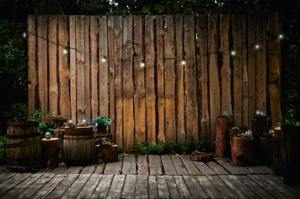 string lighting hung across wooden garden fence