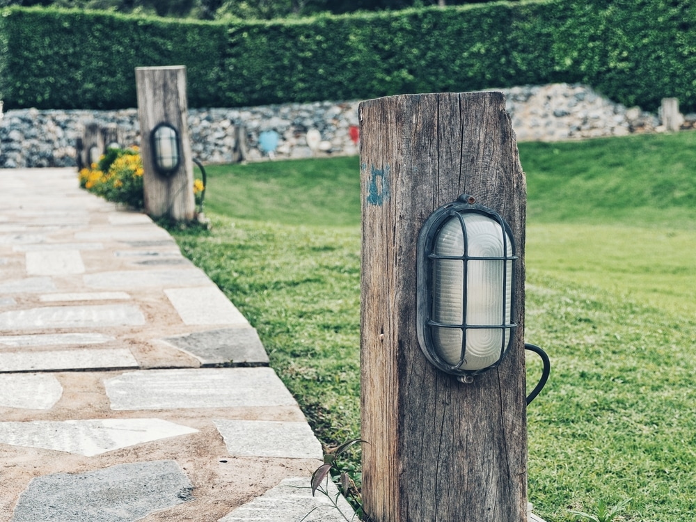 naval style lighting on wooden posts