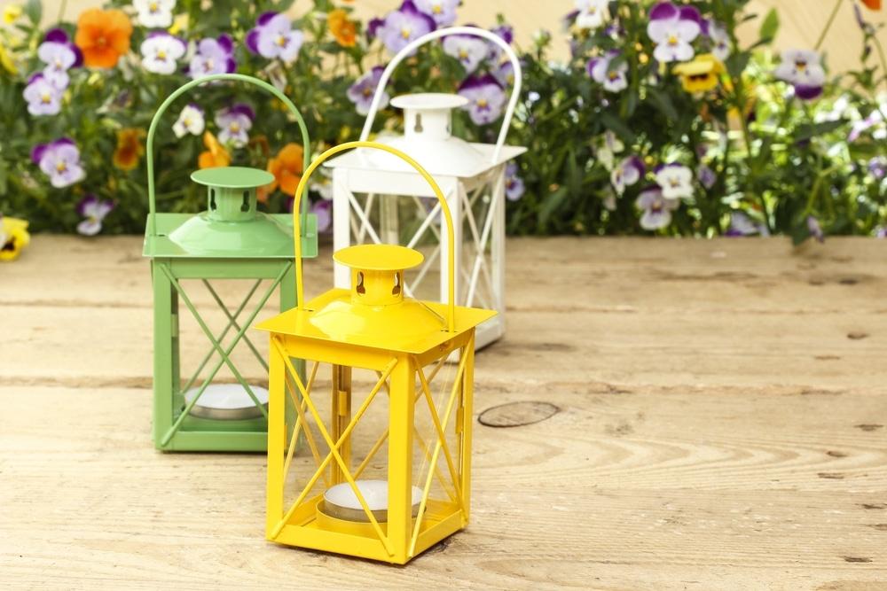 tea light lanterns sat on wooden surface