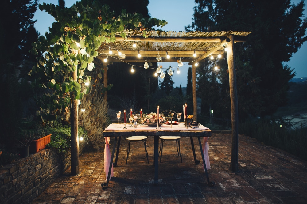 pergola lit up with dining table