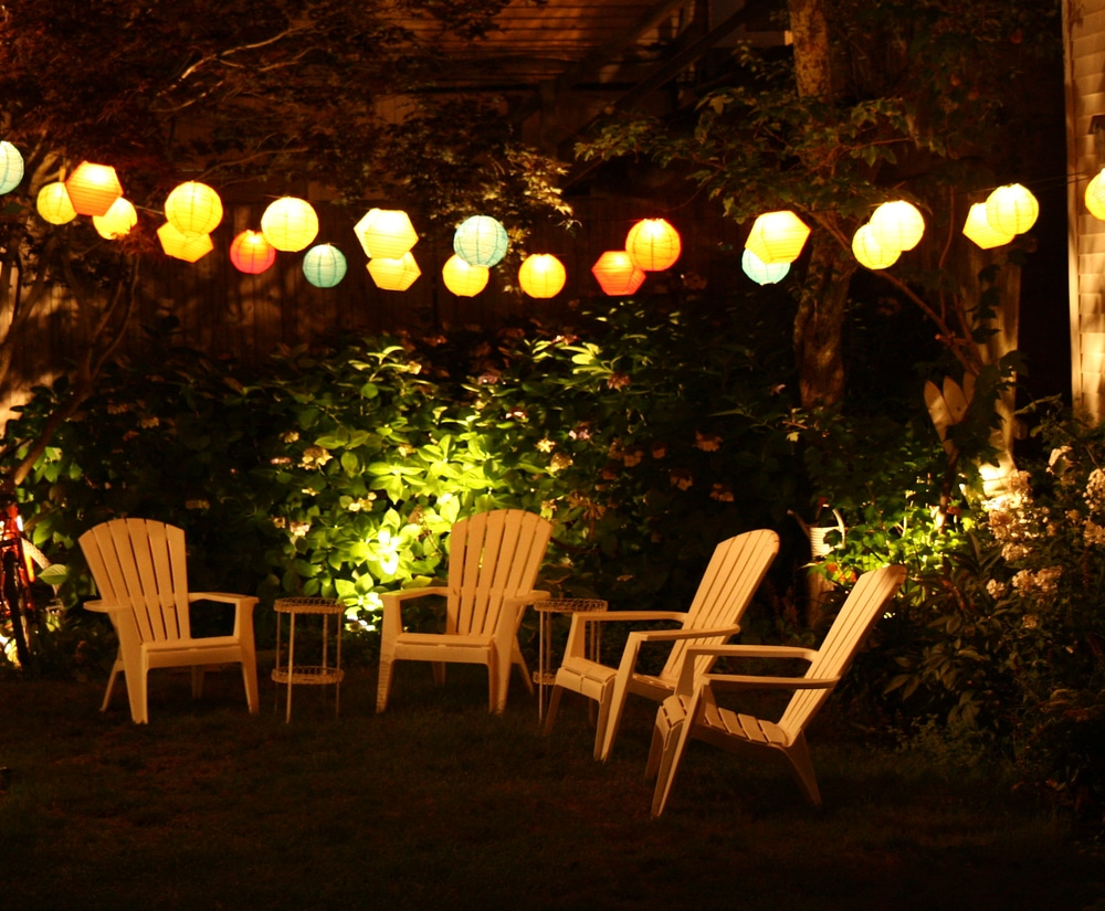 colourful lanterns above lawn chairs