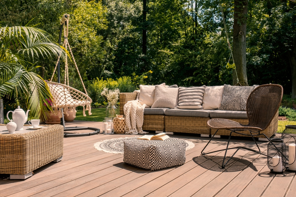 beautiful composite decking with swing seat and other garden furniture