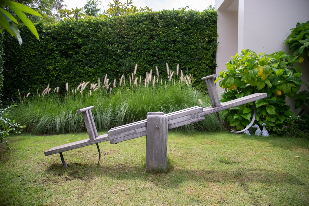 wooden seesaw in garden