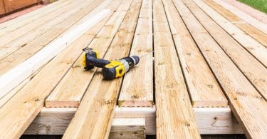 partially built decking with hammer drill laid on boards