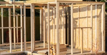 an unfinished garden shed under construction
