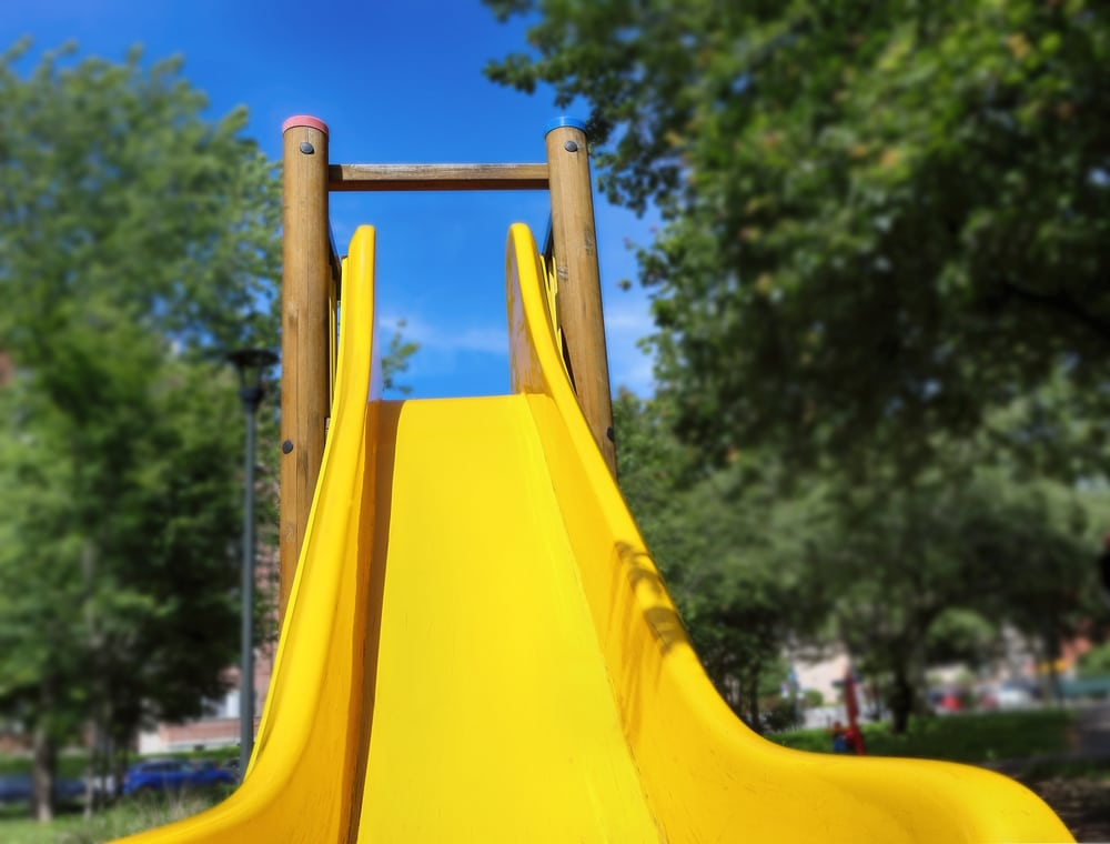 bottom of a yellow kids slide