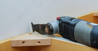 an oscillating multi tool in use