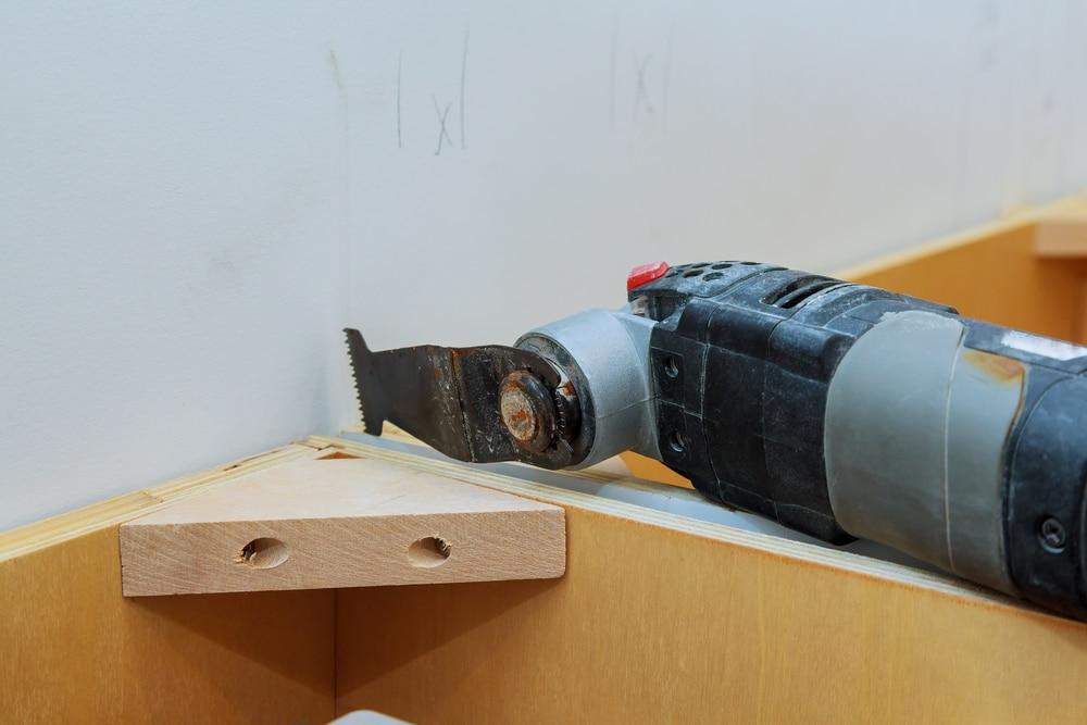 an oscillating multi tool in use