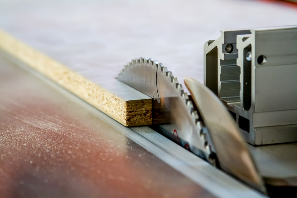 table saw cutting through wood