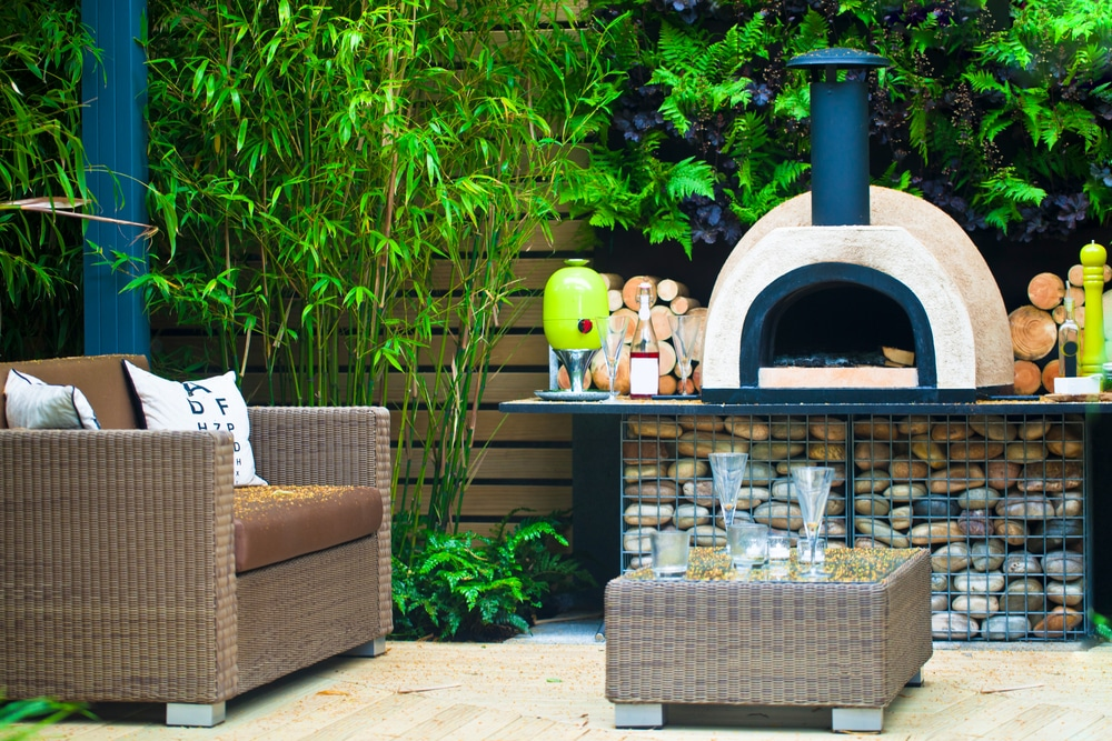 a wood fired pizza oven in a garden
