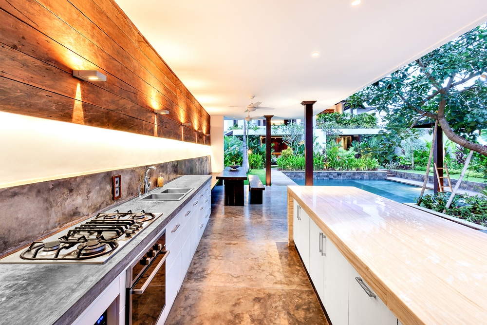 an open garden kitchen with a pool