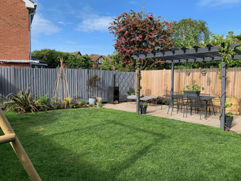 lawn area with new planted section and an extended area for sun loungers next to the pergola