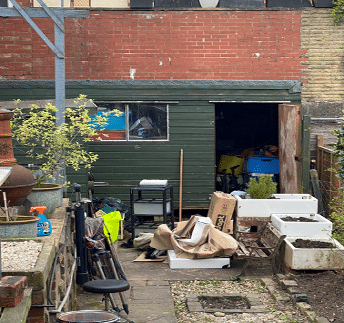 messy garden shed with clutter outside