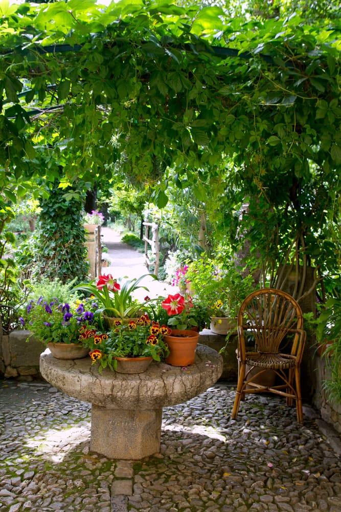 flower pots on stone table in Majorca