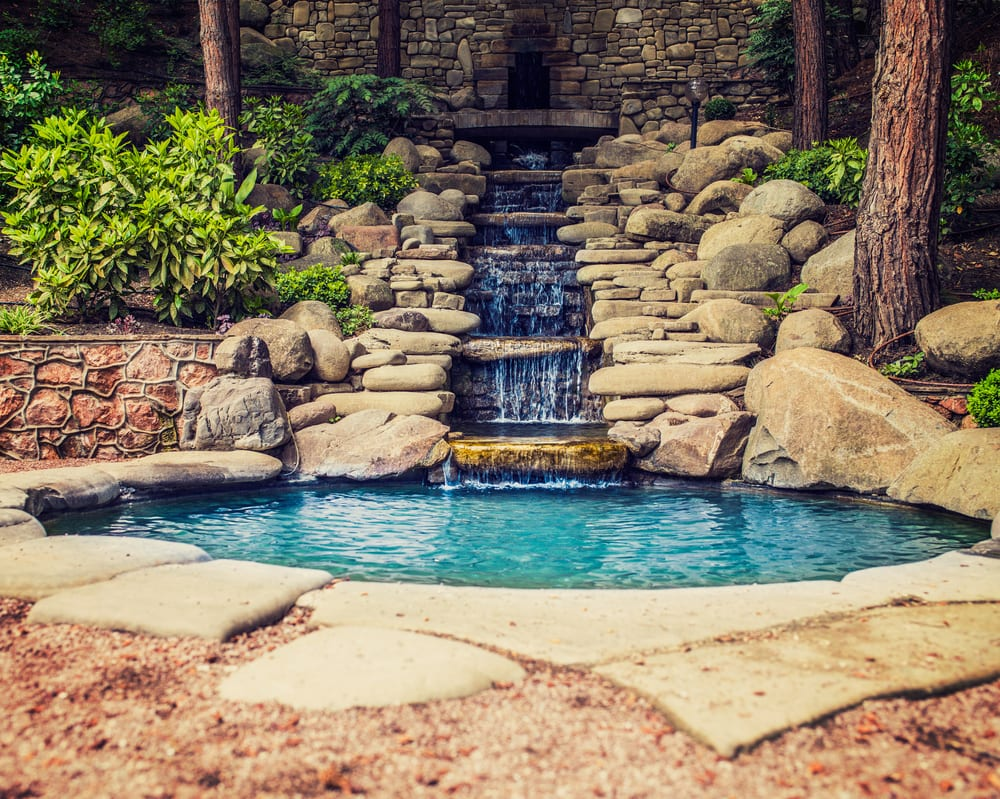 stunning asian style water feature with sloping waterfall