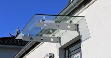 glass canopy over grey door