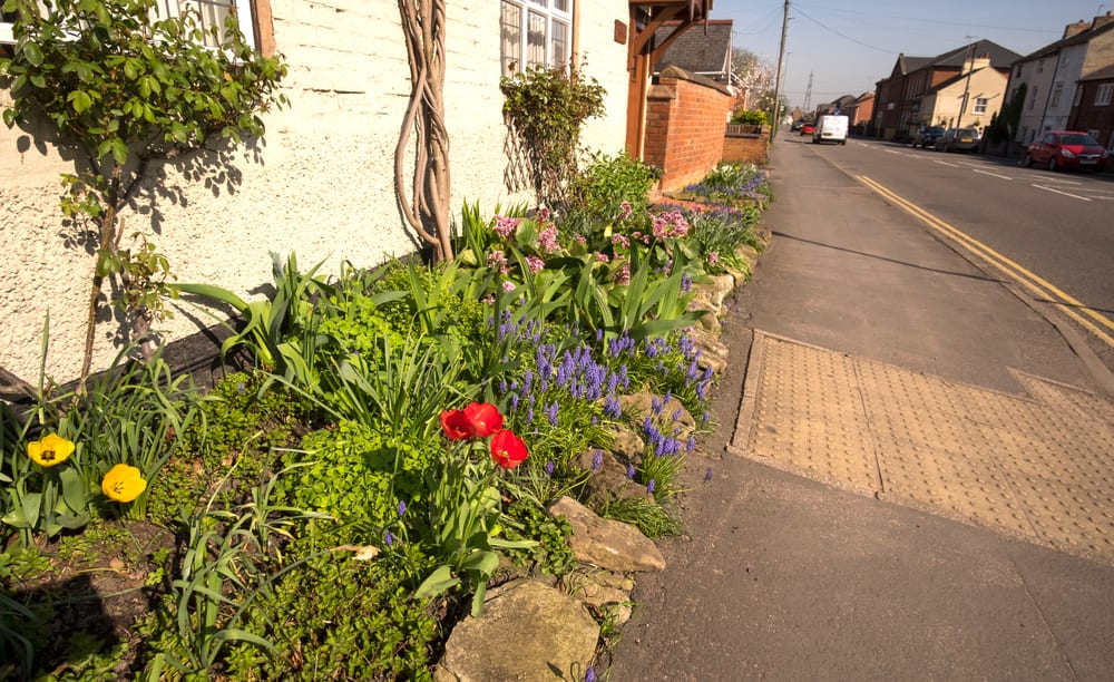 flower bed next to pavement in the UK