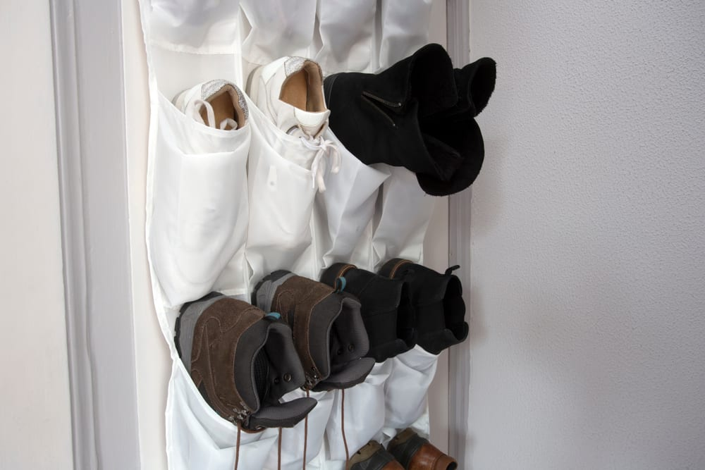 shoes hanging in a white shoe rack
