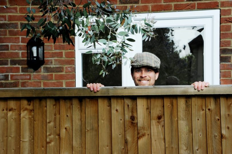neighbour poking his head over fence