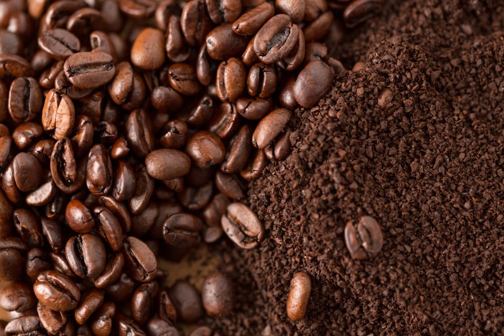 Coffee Beans and Grounds next to one another