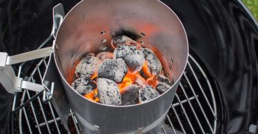 charcoal briquettes in a chimney starter
