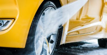 car being sprayed with a pressure washer