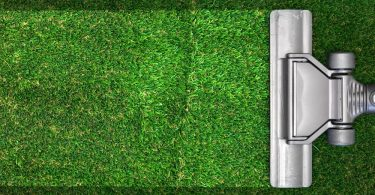 vacuum cleaning a strip of artificial grass