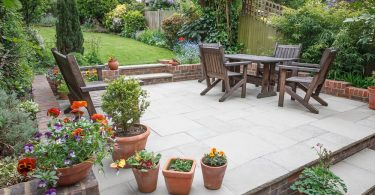 stunning raised patio with garden furniture