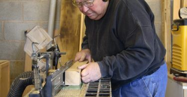 carpenter using a router table