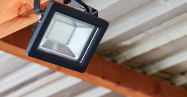 floodlight attached to a garden roof beam