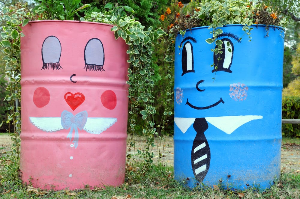 two painted barrel planters