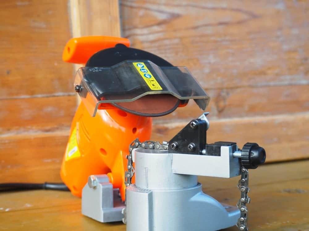 an orange electric chainsaw sharpener